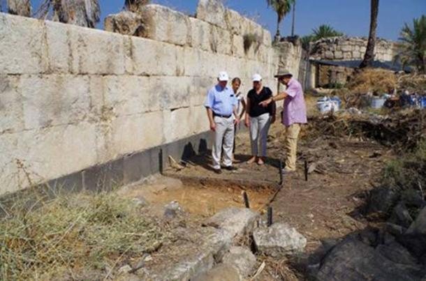 The German ambassador (left) viewing the new excavations along the eastern wall of the palace.