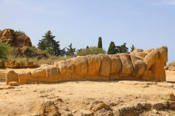 Giant Telamon, Atlas supporting statue of ruined Temple of Zeus in the Valley of Temples of Agrigento, Sicily, Italy. UNESCO World Heritage Site. (Sergio Monti Photos /Adobe Stock)