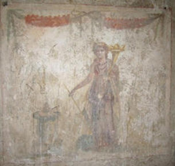 Goddess Fortuna on the wall of a the Suburban Baths in Pompeii.