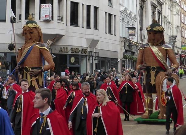 Gog and Magog being paraded through the streets of London in the Lord Mayor's Show. In myth, they were brought to London as captives by Brutus of Troy. Along with the London Stone, they help keep Lonon's Trojan myth alive in the 21st century.