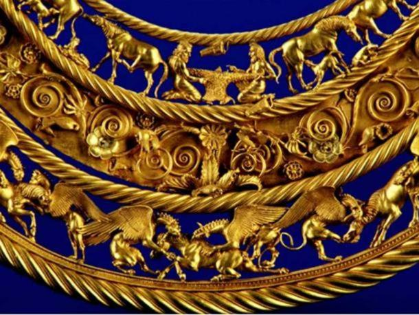 Gold Scythian pectoral, or neckpiece, from a royal kurgan in Tolstaya Mogila, Ordzhonikidze, Ukraine, dated to the second half of the 4th century BC. The central lower tier shows three horses, each being torn apart by two griffins. Representational image.