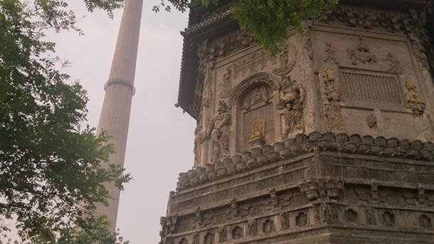 The Liao-period Tianning Temple Pagoda in Beijing, with industrial chimney in background. (Jonathan Dugdale/ Author provided)
