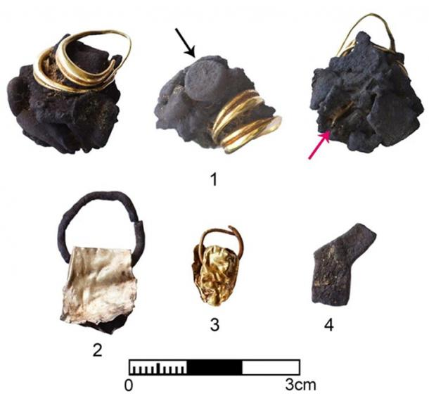 Gold and silver jewelry from a home. The arrows point to a silver amulet and another gold object inside the molten silver