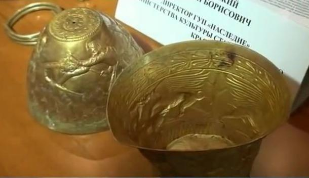 Golden vessels and bracelet discovered by archaeologists in a kurgan near Strovopol in 2013.