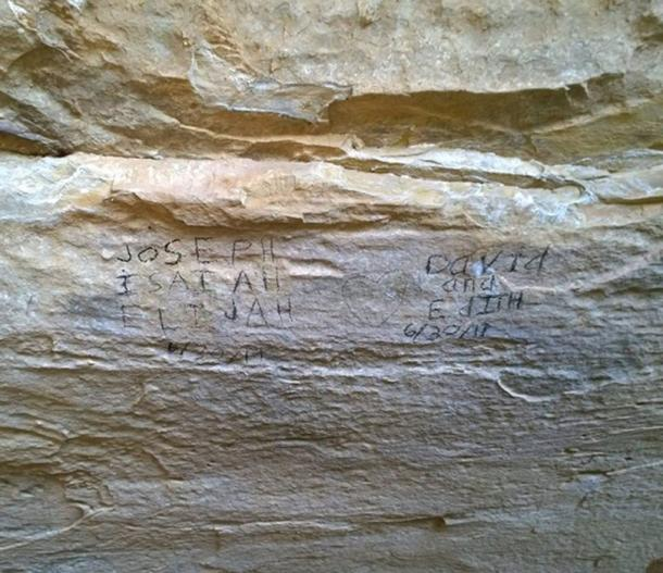 Graffiti created using prehistoric charcoal dug up at the site (Credit: Mesa Verde National Park)