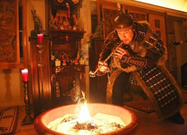 Grandmaster Anatole performs shaman ceremony in front of Fox Altar.
