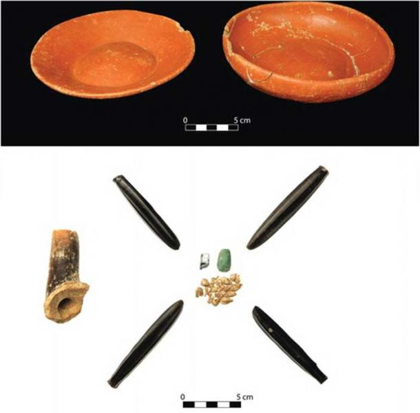 Grave goods, including obsidian, found in a burial of two sacrificed children.