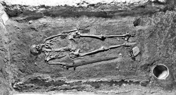 Photo of grave IIIN199, shortly after excavation in 1928, showing the controversial skeleton of what is now known as being a Slavic warrior. (Institute of Archaeology of the CAS / Prague Castle Excavations)