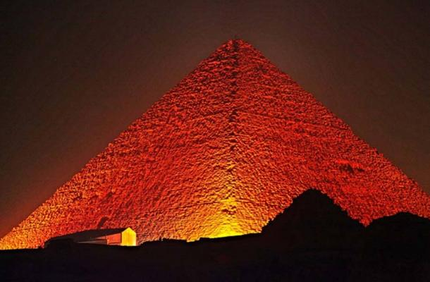Evidence of their seemingly impossible technological manifestations—the Great Pyramid being among the most widely recognized, with many others gaining attention—lies in ruins around the Earth, the implications largely ignored by experts who can't adequately explain them within academically accepted contemporary models. Great Pyramid of Giza at night.