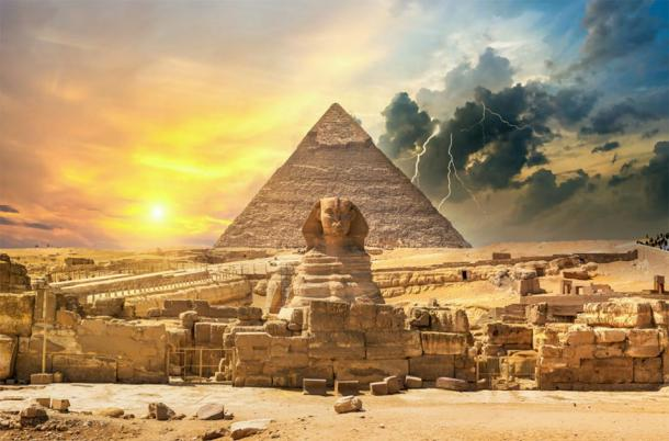 The Great Pyramid of Giza and the Sphinx with a storm in the background. (Givaga / Adobe stock)