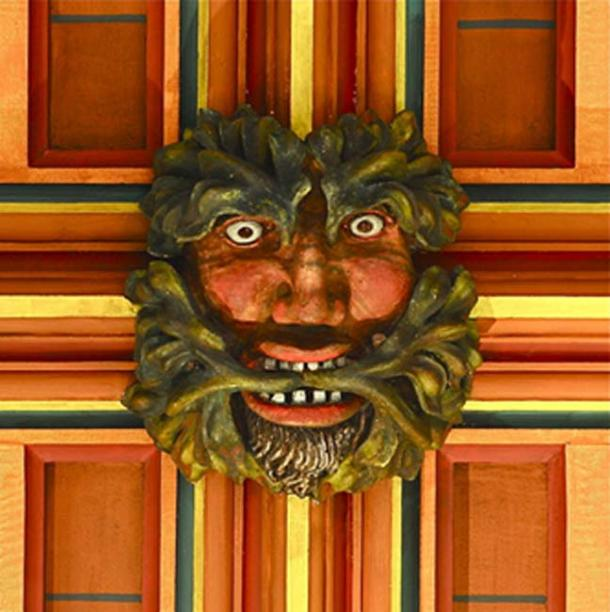 Green Man painted on a wooden roof boss in Rochester Cathedral, Kent (medieval). (Public Domain).