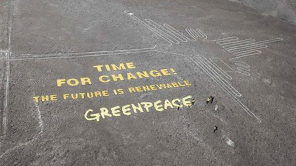Greenpeace message on the landscape at Nazca next to an ancient geoglyph.