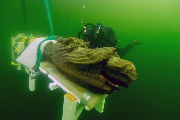 The Gribshunden shipwreck came to media attention when archaeologists salvaged a fabulously well-preserved wooden figurehead of a dragon-like monster from the stern and brought it to the surface. (Blekinge Museum)