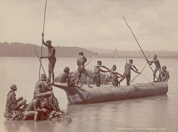 Group of Andaman Men and Women, Some Wearing Body Paint And with Bows and Arrows, Catching Turtles from Boat on Water. (Public Domain)