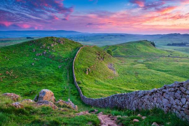 """Hadrian's Wall, whose construction had begun in 122, marked the boundary between Roman Britain south of the wall, and the """"barbarian"""" Caledonia to the north. (drhfoto / Adobe Stock)"""