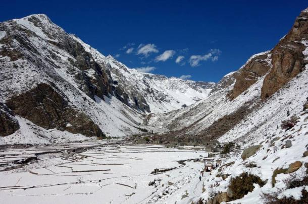 Halji village and its cultivated terraces covered by snow.