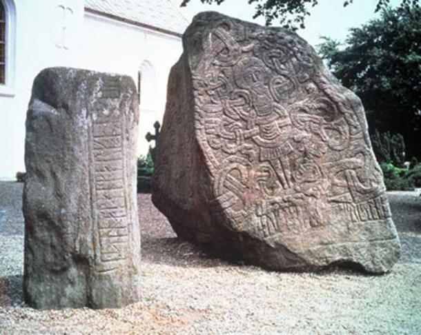 Harald's rune stone showing Christ stands in front of Jelling Church, beside his father Gorm's stone for Queen Thyra.