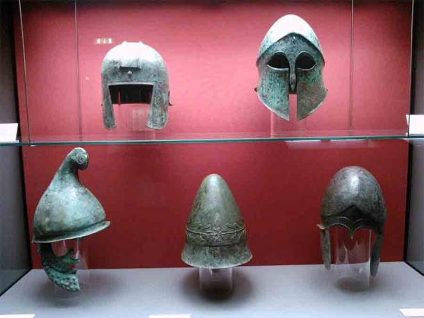 Ancient Greek helmets: Top (from left to right): Illyrian type helmet, Corinthian helmet. Bottom (from left to right): Phrygian type helmet, Pileus, Chalcidian helmet.  (Staatliche Antikensammlungen / CC BY-SA 4.0)