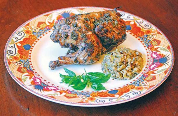 """Hen with Herbs"". Laura Kelley recreates Recipe 2 from Yale tablet 8958. (Laura Kelley) This version was made with pigeon, salt, water, fat, vinegar, semolina, leek, garlic, shallots, tulip bulb, yogurt or sour cream, and ""greens."""