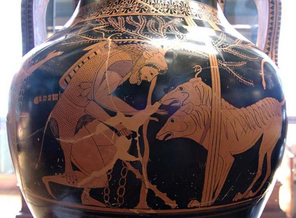 Heracles, chain in left hand, his club laid aside, calms a two-headed Cerberus, which has a snake protruding from each of his heads, a mane down his necks and back, and a snake tail. (Public Domain)