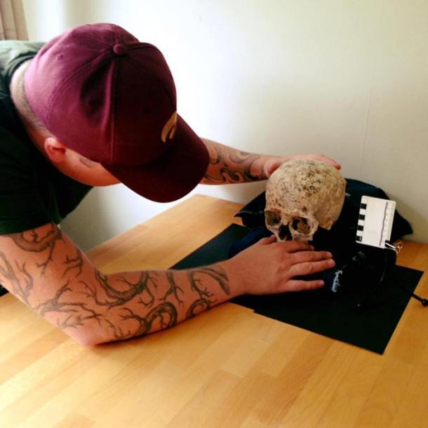 Hew Morrison studying the skull of 'Ava'.