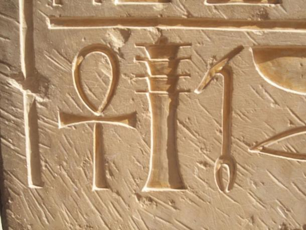 Hieroglyphic symbols from left: the Ankh- symbolizing life, the Djed- symbolizing strength and stability, and the Was scepter- symbolizing power. Reliefs at Deir el-Bahri, Egypt.