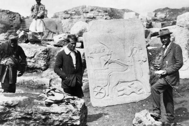 E Lawrence with Leonard Woolley, the archaeological director, with a Hittite slab on the excavation site at Carchemish near Aleppo before the First World War. An archer riding a chariot can be seen on the slab.