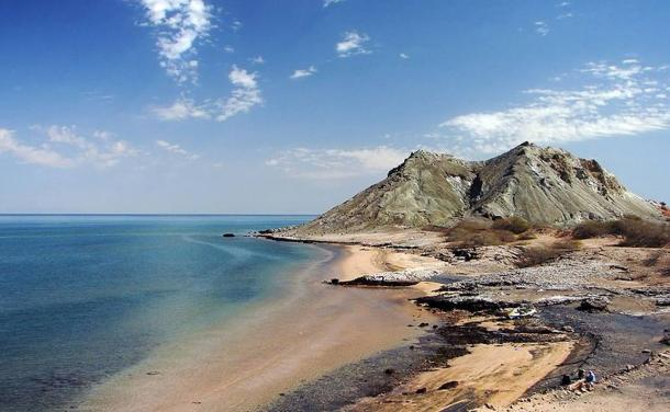 The rocks and sandy beaches of Hormuz Island, Persian Gulf, Iran.