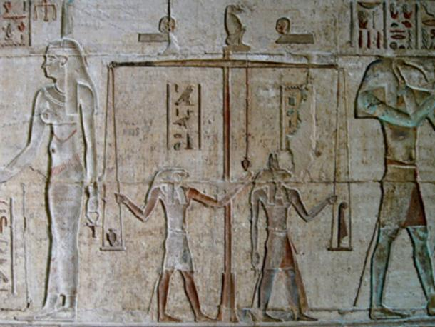 Horus grasping a plumb bob in a 'Weighing of the Heart' ceremony relief in the temple of Hathor at Deir el-Medina. (Oltau / CC BY 3.0)