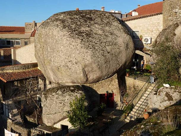 House constructed under a rock in Monsanto.