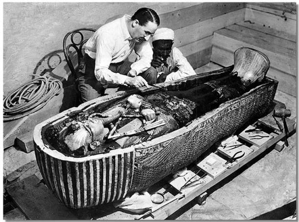 Howard Carter opens the innermost shrine of King Tutankhamun's tomb near Luxor, Egypt which one of Carter's water boys found the steps to.