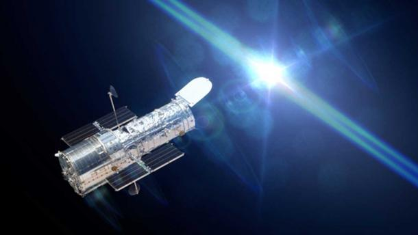 Hubble Space Telescope observing a star. (dottedyeti / Adobe Stock)