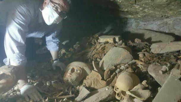 Human remains and artifacts were found scattered in the tomb.