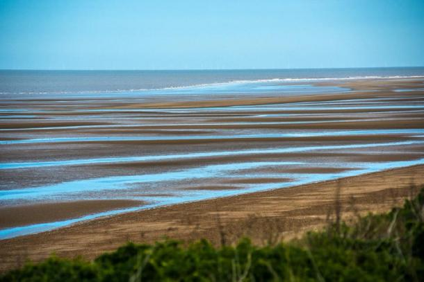 Old Hunstanton beach, where Seahenge was found, at low tide in Norfolk, UK. (Andrew / Adobe stock)