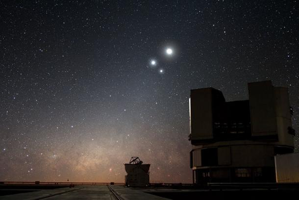 View of the night sky over ESO's Very Large Telescope (VLT) observatory at Paranal, Chile, showing the Moon, Jupiter and Venus, during a planetary conjunction. While it appears they are colliding, these planets are actually millions of kilometers apart. (ESO / Y. Beletsky)