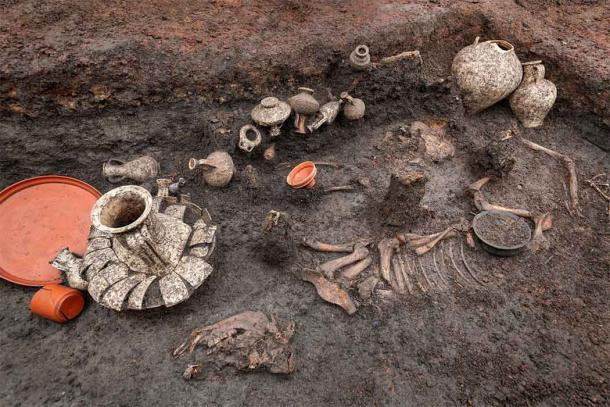 The Roman baby burial included an infant skeleton, surrounded by a pet dog, a pig, twenty terracotta vases and various food and meat offerings. (Denis Gliksman / INRAP)