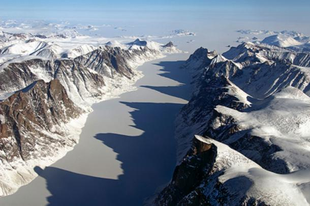 Ice covered fjord on Baffin Island with Davis Strait in the background. Baffin Island is the largest island in the Canadian Arctic Archipelago and fifth largest island in the world. Credit: NASA / Michael Studinger