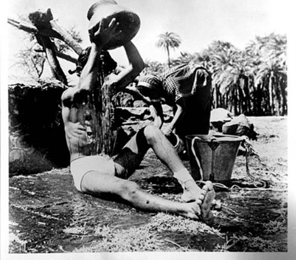 In the ancient world water sources were often lethally polluted, for example, in this 1949 photograph of a diseased man in India bathing near a well and polluting the drinking water. Water sources protected by temple monks were assured to be pure, adding greatly to their perceived holiness, in that they didn't kill. (Public Domain)