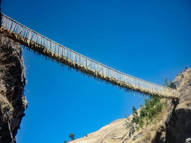 Suspension bridge Q'eswachaca hanging over the Apurimac river, Quehue, Cusco, Peru. (Mark /Adobe Stock)