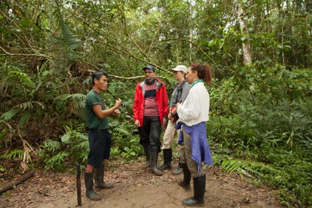 Indigenous guide, Pidru, explains the uses of some of the plants in the Amazon jungle of Ecuador. Credit: April Holloway