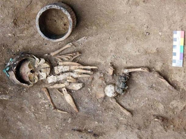 Infant discovered in 4,500-year-old burial mound with eight intricately carved figurines. Credit: Image courtesy Yury Esin.