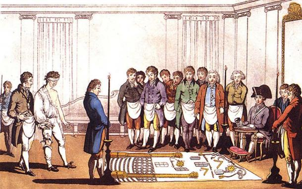 Initiation of an apprentice Freemason around 1800. This engraving is based on that of Gabanon on the same subject dated 1745. The costumes of the participants are changed to the English fashion at the start of the 19th C and the engraving is colored, but otherwise is that of 1745.