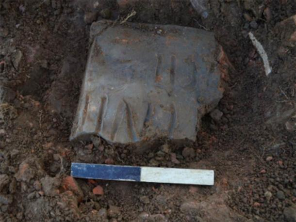 Inscribed tile in-situ: ...ENII (F)ECIT - Perhaps '()nenti' or '()nenus' FECIT = 'has made' – so perhaps the name of the tiler. (Oxford Archaeology East)