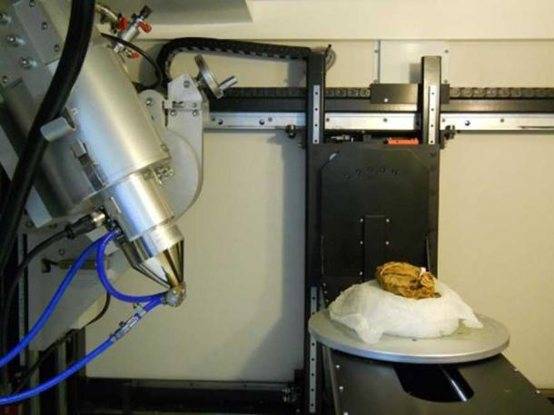 Inside the x-ray CT scanner at the Imaging and Analysis Centre, NHM, London. X-ray source on left of image, on the right of image the bundle on turntable behind it is one of the x-ray detector plates. (Iron from the sky project)