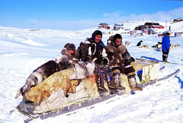 Inuit people on a traditional qamutik (sled), Cape Dorset. (Ansgar Walk/CC BY SA 2.5)