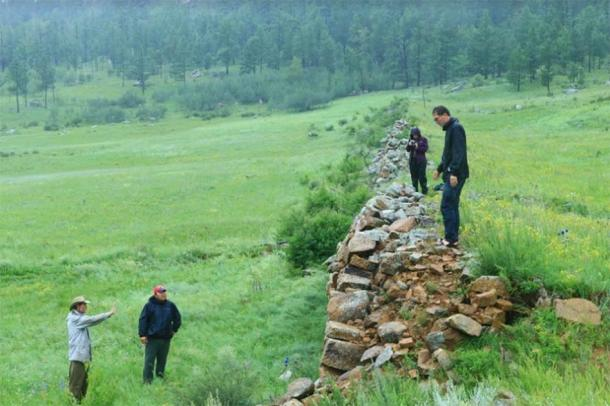 Investigators assess one section of the wall. (Antiquity Publications Ltd)