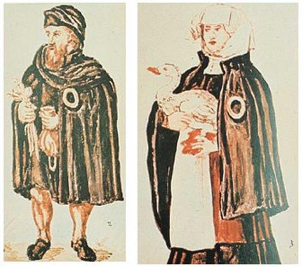 A Jewish couple from Worms, Germany, with the obligatory yellow badge on their clothes. The man holds a moneybag and bulbs of garlic, both often used in the portrayal of Jews. 16th century. (Public Domain)