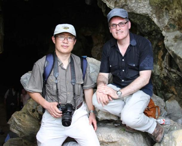 The author and colleague Ji Xueping at a Palaeolithic cave in southern China.