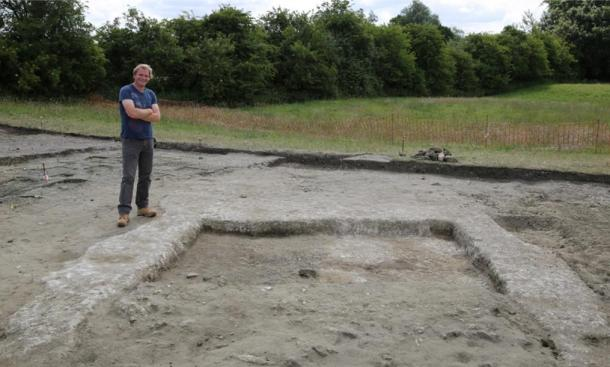 Jim Leary, lead archaeologist, with the remnants of the walls and the floor of the ancient home at Marden Henge