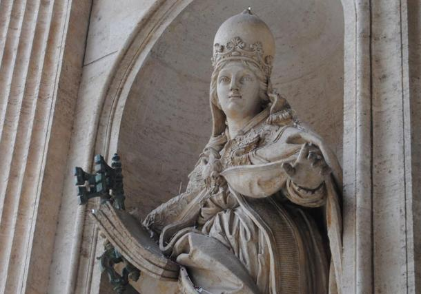 The statue that still stands in Rome is Joanna with a papal crown.
